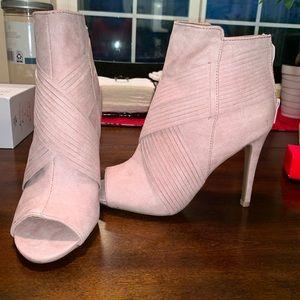 Blush suede stiletto heels.